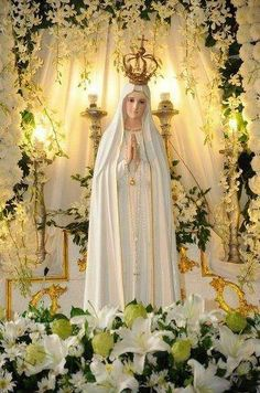 Our Lady of Fatima statue amidst flowers