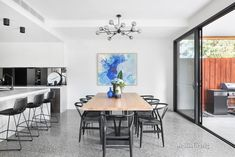 Blue hues with a touch of greenery for the perfectly modern space. #JellisCraig #home #interiors #dining #art #home