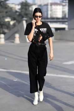 Who: Kendall Jenner  What: A Waist Bag  Why: Jenner got innovative with an old school fanny pack, wearing it slung across her body instead of around her waist, paired with a graphic tee and wide leg black denim.  Get the look now: Asos waist bag, $28, asos.com.