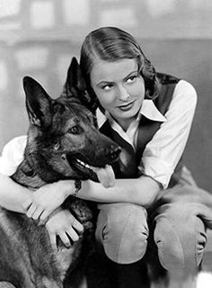 Ingrid Bergman, perhaps during the 1930s, poses with her doggie.  lmr