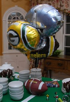 Tie the team's balloons around a real football as the weight. #HomeBowlHeroContest