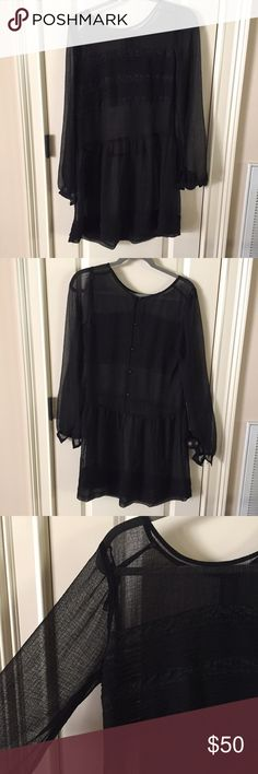 Free People sheer black long sleeve dress sz. S Brand new without tags. This is a beautiful sheer black dress from Free People with slight lace detail. It fits like a size small and I will be happy to provide measurements. Trying to find a stock photo and will update if I do. Please ask any questions. Bought at the Free People sample store. The slip probably didn't come with it, but it's a soft black slip that works great underneath!! Free People Dresses