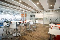 Coalesse Enea Lottus Sled Stools and Enea Lottus Tables provide informal work space in Akamai's office cafe.