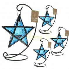 Set Of 8 Blue Glass Star Hanging Candle Lanterns D1138 Make a wish on this beautiful blue star! Simply add a candle to this lovely accent lantern