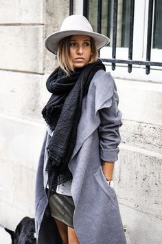Camille Callen wears awesome cream fedora with her grey marl coat and leather skirt.Coat: Missguided.