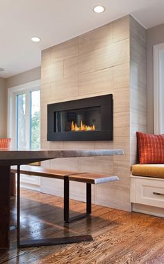Loving this #modern fireplace mounted higher up on the wall in the #dining area. Do you know your ideal #fireplace height?