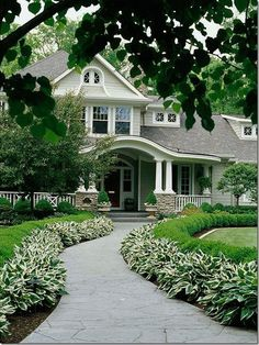 Landscaping & a front porch both add curb appeal & value to your home