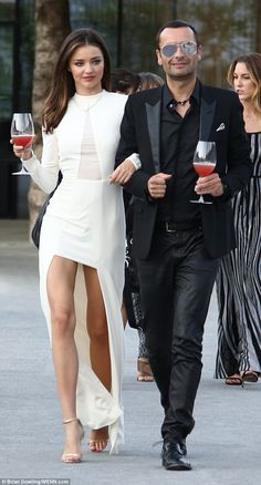 Cheers to the good life! Miranda Kerr and CEO of Swarovski, Robert Buchbauer, stroll into the launch of the supermodel's Swarovski Exclusive Collection by Miranda Kerr launch event in Austria on Thursday evening