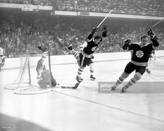 Bobby Orr #4 of the Boston Bruins flies through the air after sliding the puck past goalie Glenn Hall and tripped by Noel Picard of the St. Louis Blues as Orr scored the game winning overtime goal during Game 4 of the 1970 Stanley Cup Finals on May 10, 1970 at the Boston Garden in Boston, Massachusetts. The Bruins defeated the Blues 4-3 and won the series 4-0.