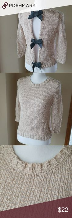 Rachel Roy sweater with bows in back Rachel Roy sweater with bows in back.  Light taupe sweater with dark gray bows down the back. RACHEL Rachel Roy Sweaters