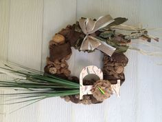 "Natural ""fisherman"" burlap wreath. I made this from supplies bought entirely from Hobby Lobby."