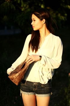 white blouse, shorts, brown clutch, pink lips