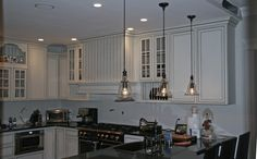 Love the white cabinets and pendant lights