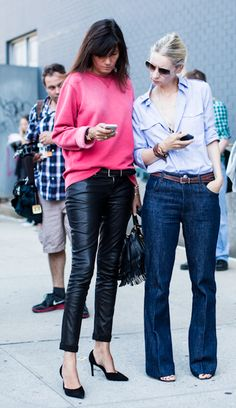 more skinny leather pants and coral sweatshirt, this time with stylish friend in a wider legged jean. nice!