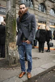 With jeans, brown boots and jacket