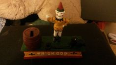 Vintage Cast Iron Trick Dog Bank Replica.
