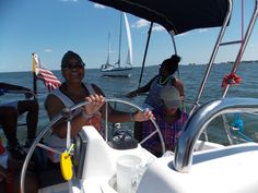 A delightful family from Baltimore spanned three generations as they intuitively learned how to sail on Sunday along the York River. Brisk winds powered them ahead of a much larger sailboat (background) as grandchildren cheered Grandma on (at the wheel).