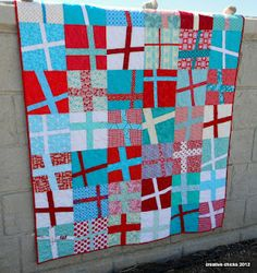 Wonky crosses quilt by Quilt Story.