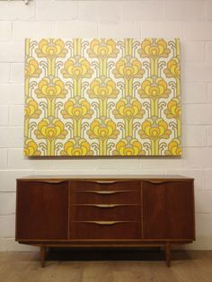 Wall panels like this could be created by using vintage wallpaper on a ready made canvas - less commitment, less 'busy' and less vintage paper required