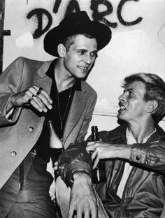 Paul Simonon and David Bowie backstage at The Clash's concert at Shea Stadium