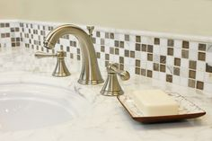 Thin strip of glass tile as a bathroom vanity backsplash.