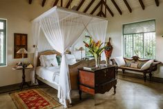 The panel on the wall was originally displayed in a Buddhist temple. British Colonial Bedroom, British Colonial Style, Small Bungalow, Dream Beach Houses, Tropical Houses, Renting A House, Room Inspiration, Outdoor Living, Outdoor Rooms