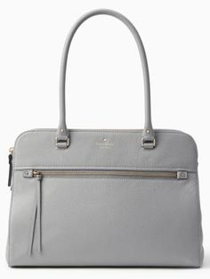 the subtle curves of this functional handbag add a ladylike vibe; carry it with everything from boyfriend jeans to a business suit for a clean, polished look.