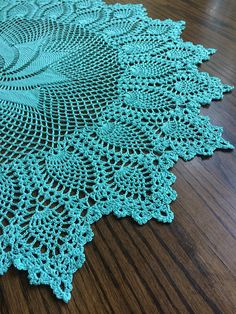 This is a hand crocheted doily. It is measured about 29 inches in diameter. A total of 10 pinwheels on the center part with pineapples around it. Perfect for round table, coffee table, table centerpiece and it would make a lovely gifts for housewarming. It has been slightly