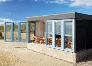 East Beach Coast Cafe, designed by the Olympic cauldron creator to imitate a giant piece of driftwood. With an ocean filled menu, located in Littlehampton, West Sussex, England