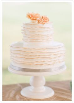 delicate two-tiered cake and simple rose topper
