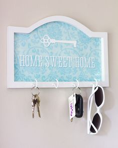 DIY Key Rack-Wooden holder: $2, Hooks: $2, Laminate: $2, but $0 for me,  Spray Paint: $0 (already had), Total: $6  Bought wooden holder from Hobby Lobby, painted it white, cut out the shape of the HOME SWEET HOME design with an Xacto knife after it has been laminated, buy 4 white screws, then screw it into the wall or hang.