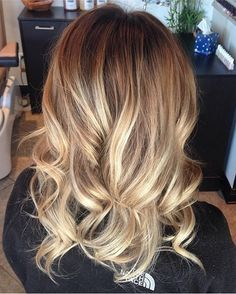 A mix of honey hued and lighter highlights on a naturally darker blonde base is truly a gorgeous shade. Case in point with this color by hair stylist Celine Fenton.