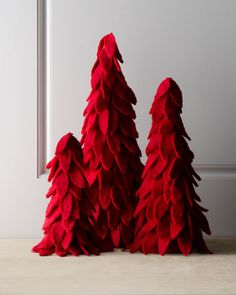 """Artisan"" Red Felt Christmas Trees by Arcadia Home at Horchow. These trees are amazing, but waaaaay overpriced! Definitely could be done with foam tree forms, felt, a glue gun and a DIYer who has the sense and skill to not glue their fingers together (read: not it!)"