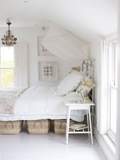 baskets for under bed storage....Cozy beach bedroom.