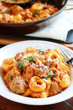 This Italian Sausage Tortellini is bursting with rich, fresh flavors. A decadent, creamy tomato sauce surrounds pillowy soft, cheesy tortellini and bold, seasoned Italian sausage. It's like something everyone would rave over at a restaurant, but you made it at home. And my favorite thing about this recipe? It's another one of our signature One-Pot Dinners. It's so …