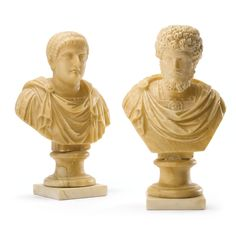 A pair of Italian Grand Tour carved alabaster busts of Octavian and Lucius Verus 19th century. Heights 12 in., 12 1/2 in. (30.5 cm, 32 cm).