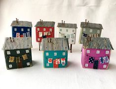 Heres a quirky slant on a new home gift or fifth wedding anniversary gift with this whimsical house ornament. This rustic art will blend in to your rustic art collection or make a gorgeous gift for Mum this Mothers Day. My little wooden houses are a cute abstract version of the shabby