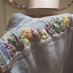 Here's the back of the denim vest I've been working on as a Custom Order! I draped the garment over my arm and held it up to my… Denim Jacket Embroidery, Embroidered Denim Jacket, Embroidery On Clothes, Embroidered Clothes, Diy Embroidery, Embroidery Stitches, Flower Embroidery Designs, Diy Clothing, Diy Fashion