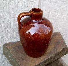 Vintage Stoneware Glazed Whiskey Jug. $9.00, via Etsy.
