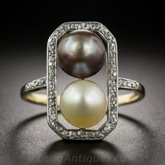 This American-made early-Edwardian ring made of 14k yellow gold topped in platinum features a pair of pearls, one in a slight yellowish cream shade and the other light purplish grey set in an octagonal frame of fifty 0.25 ct. t. w. colorless diamonds that continue down the shank and add sparkle, magnificence and elegance to this unique treasure. Perfect for any pearl-loving lady out there! www.diamonds.pro