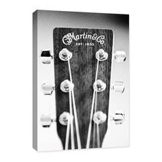 """Doodlefish - Acoustic Guitar Head Stock - Doodlefish Acoustic Guitar Sound Hole Photograph comes in two sizes and is part of a collection of 5.  The photography is reproduced as a high quality canvas print (Giclee) that is wrapped around the edges of wooden stretcher bars making it ready to hang.  The finished size is 16"""" wide by  24"""" tall."""