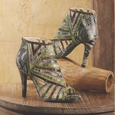 Blast Gladiator by Annie from Midnight Velvet.  A sandal with serious wow factor, this strappy number keeps every snakeskin band in place with mesh in between.