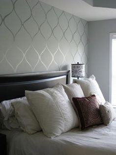 Subtle accent wall - gloss and matte paint - this is on the same theme as the gorgeous teal and silver (with the chair in front of it) - but it's not wallpaper! Great idea, much less expensive to install, and just about as much labor time. Pretty classy.