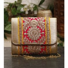 This is a pink and yellow clutch with sequins and zari work. It comes with a hidden magnetic closure for easy use. The clutch can be hand held or carried with the chain.Size: 6.5 x 6 x 2.5 Inches Klic