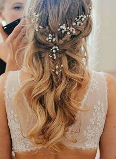 10 Pretty Braided Wedding Hairstyles: #5. Fishtail Half Up Half Down Hairstyle with Flowers