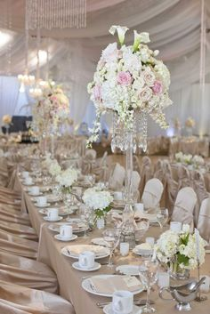 Pink pastel bouquets in a floral chandelier | Linen Effects - Minneapolis, MN | Linen, chair cover and table decor rentals