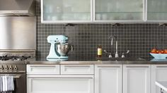 Can't get enough of the dark grey backsplash with the pale blue appliances.