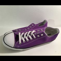 Converse purple These have only been worn once and it also comes with both shoe laces. I left it one out in the picture above Converse Shoes Sneakers