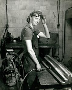 Woman grinding machined part. Curtiss-Wright, Lambert Field. (1942 to 1943) Missouri History Museum