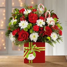 The FTD® Holiday Cheer™ Bouquet Mercy's Flowers 5500 W Flagler St Coral Gables, FL (305) 264-5053 mercysflowersonline.com provides flower and gift delivery to the entire Miami, FL area wth a large variety. #christmas #bestflorist #bestflowerarrangement #December #gift #miamiflorist #miamiflowers #floristinmiami #miamiwinter #getwell #missyou #sayitwithflowers #lastminutegift